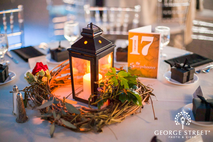 black lantern and flower centerpieces on reception table decor