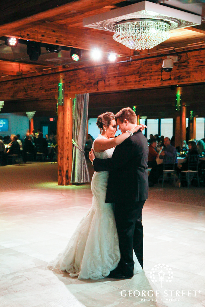 bride and groom first dance in wooden reception space