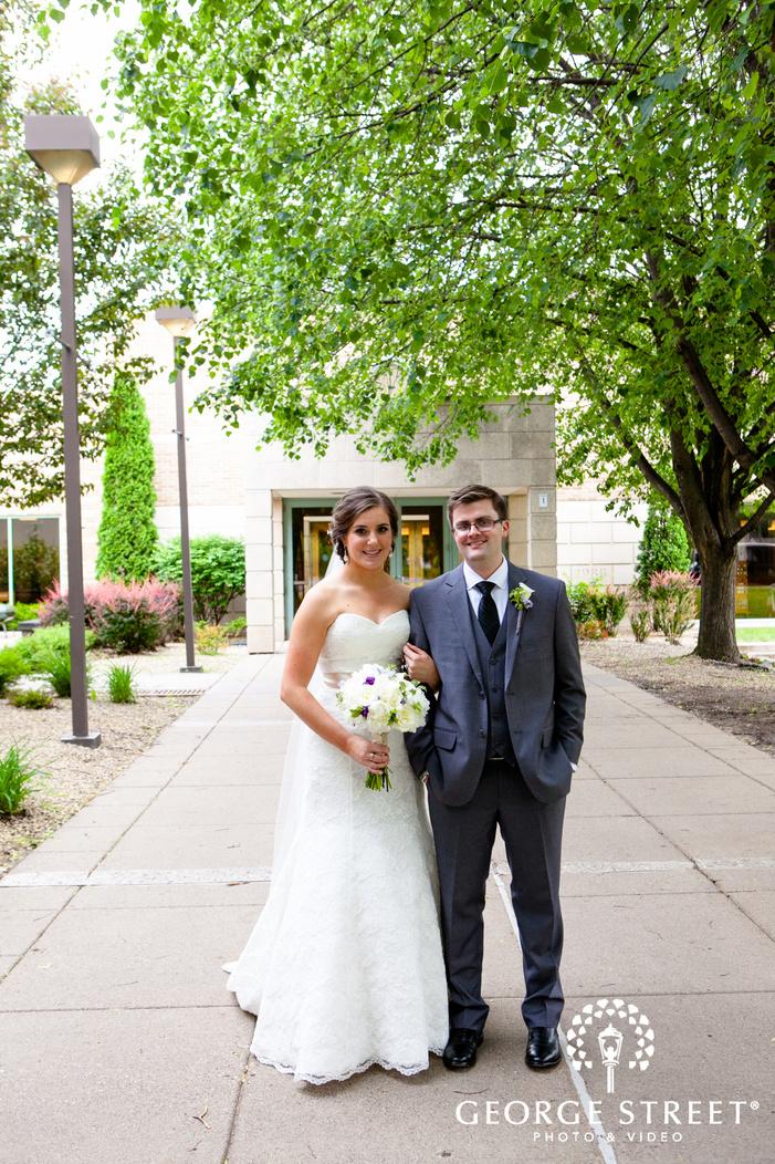 bride standing with groom in green outdoor venue