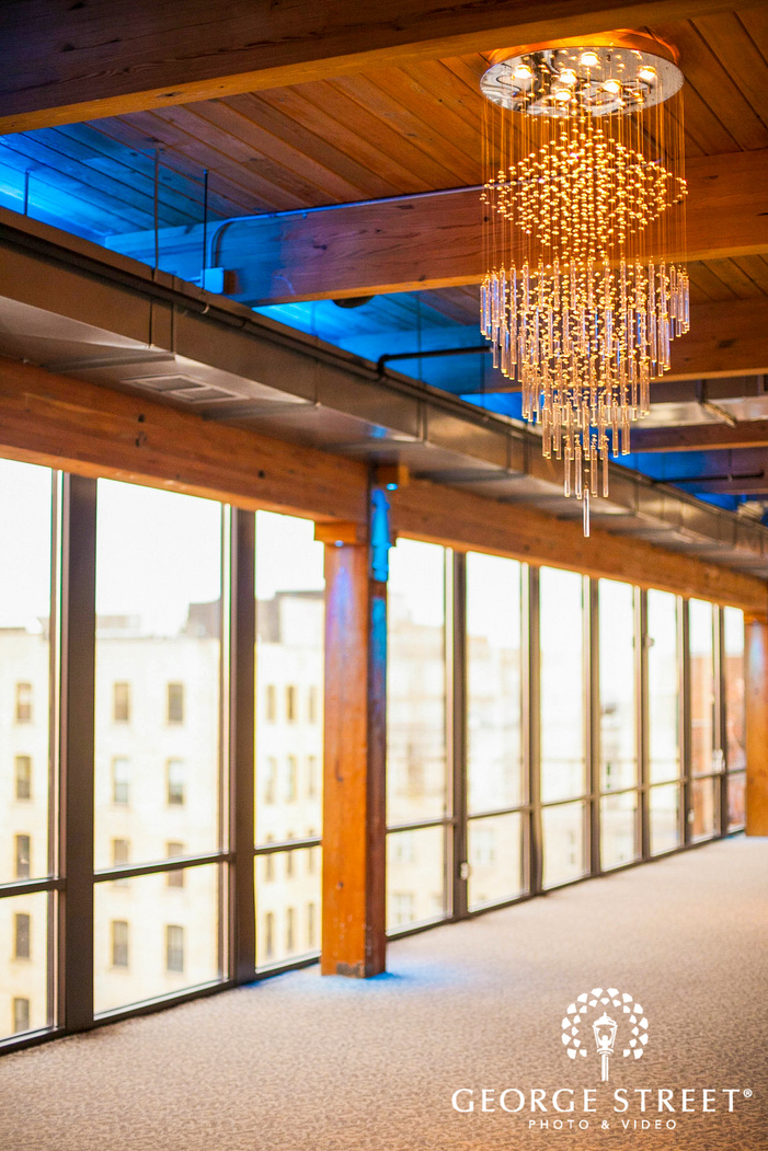 crystal chandeliers hanging from wooden ceiling at ABULAE reception venue