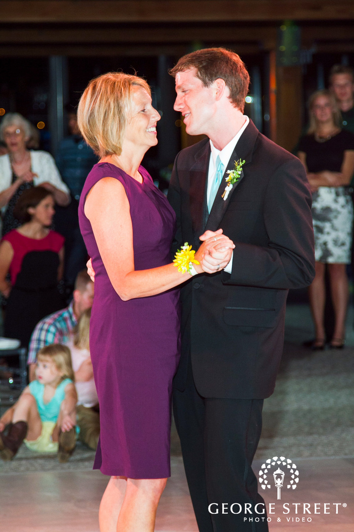 groom dancing with mother at wedding reception