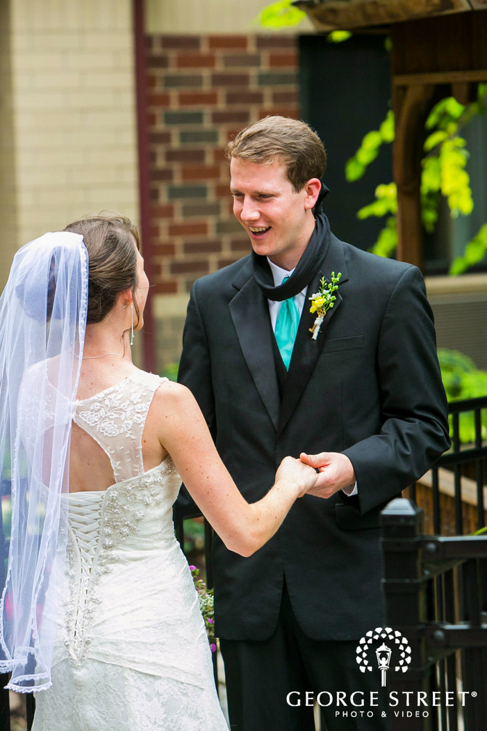 groom smiling at bride in outdoor first look moment