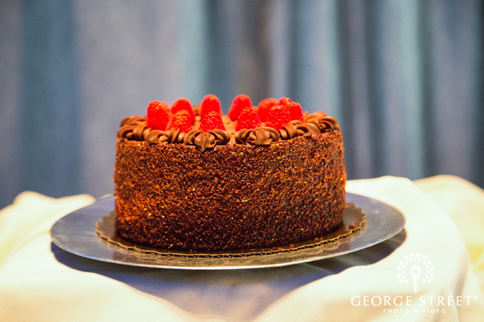 small chocolate cake covered with berries