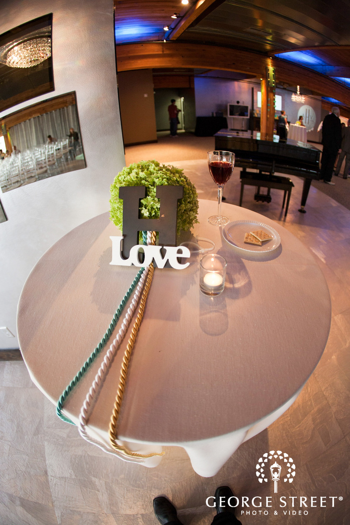 white table with letter h and love sign at ABULAE reception