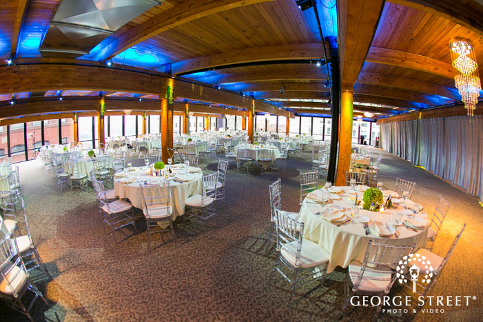 wide view of full reception space at ABULAE with wooden ceiling and white tables