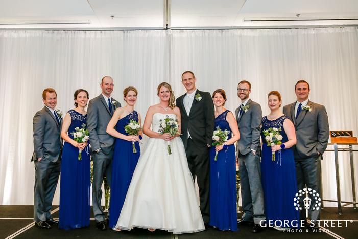beautiful bridesmaids and groomsmen group at wedding ceremony minneapolis wedding photos