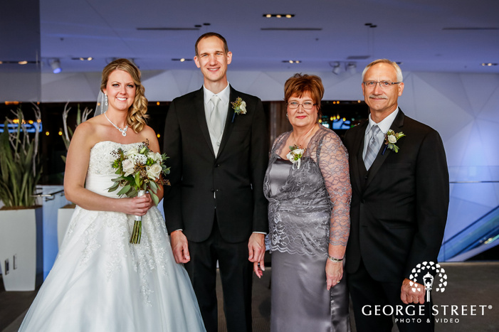blissful bride and groom with parent wedding photo