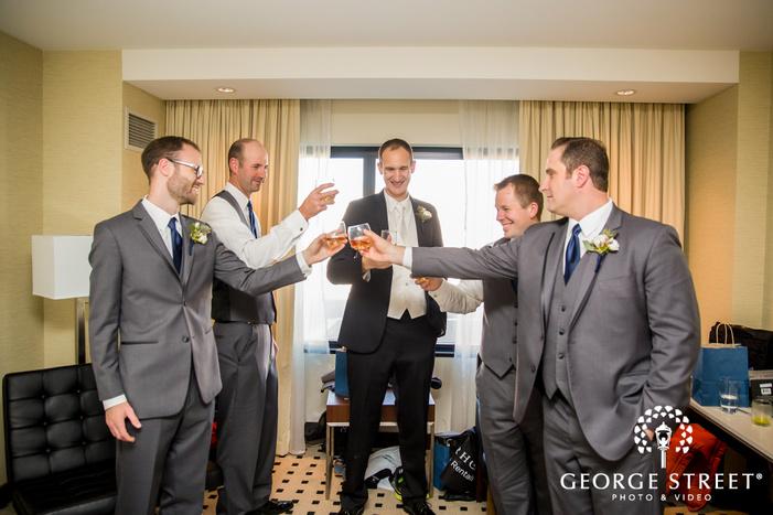 cheerful groomsmen toasting minneapolis