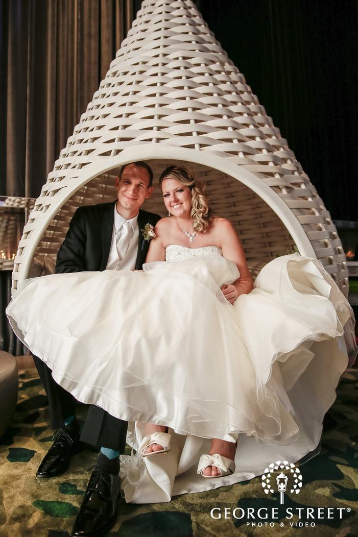cheery couple on swing chair wedding photography