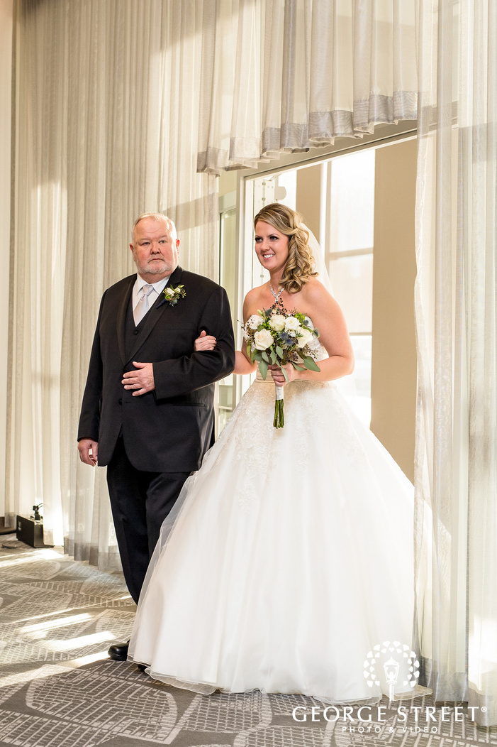 cute bride and father wedding ceremony hall entrance at radisson blu mall of america minneapolis