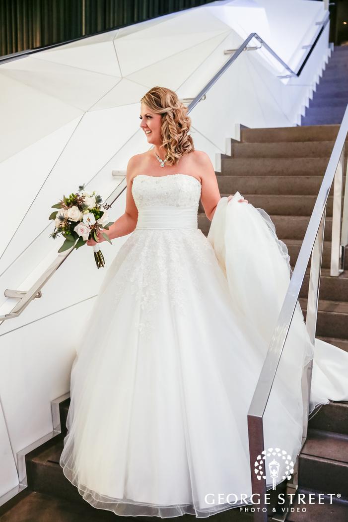 cute bride walking down the stairs minneapolis wedding photos