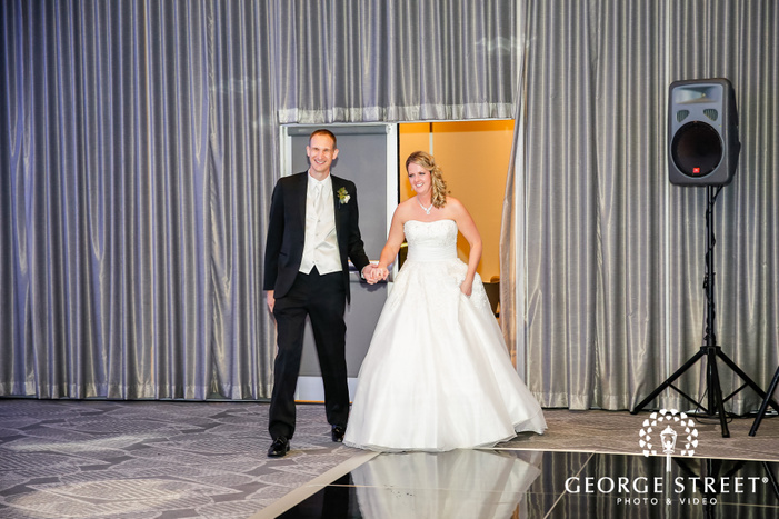 excited bride and groom entrance in reception radisson blu mall of america