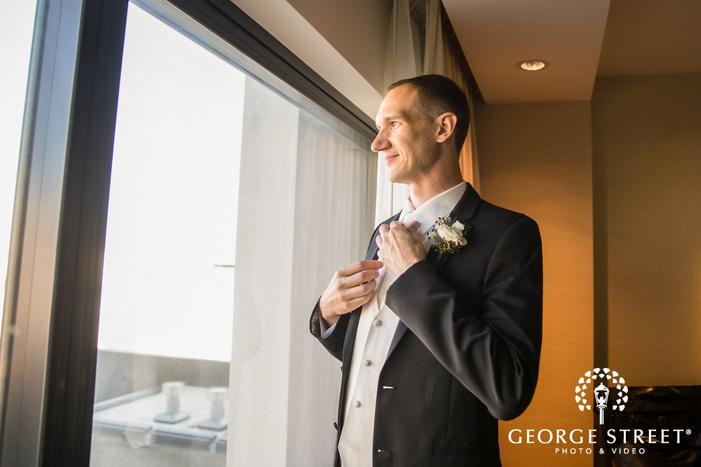 handsome groom getting ready wedding photo