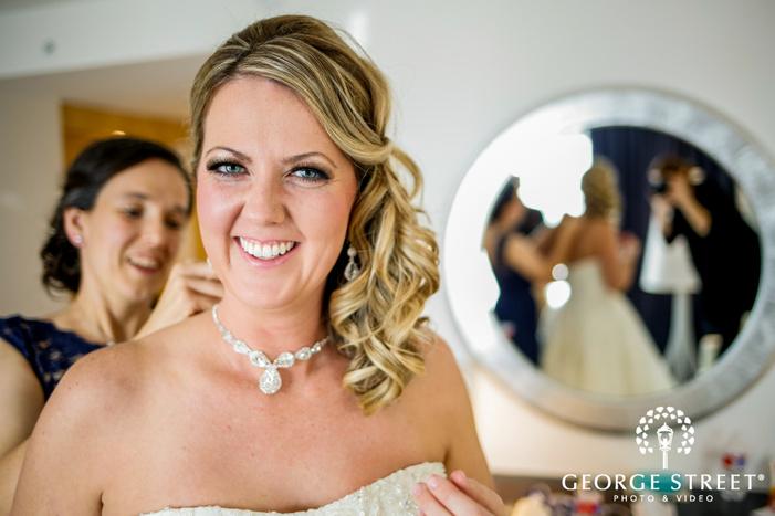 happy bride wearing accessories at radisson blu mall of america wedding photos
