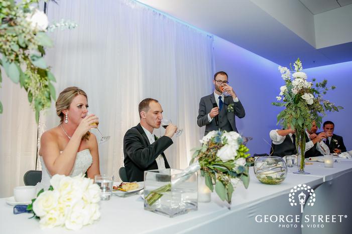 happy groomsman toast at reception table radisson blu mall of america minneapolis