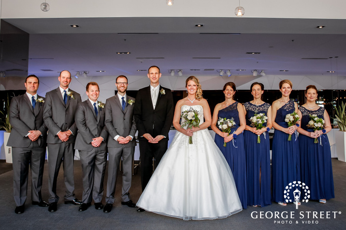 jovial bride and groom with friends in radisson blu mall of america wedding photography