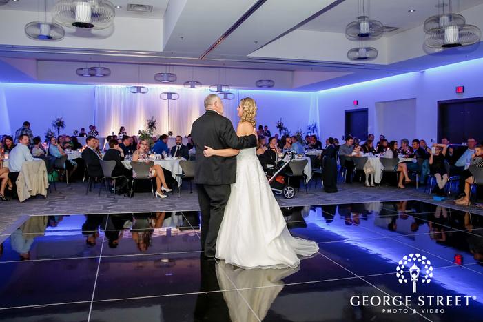 loving father and bride dance in radisson blu mall of america minneapolis