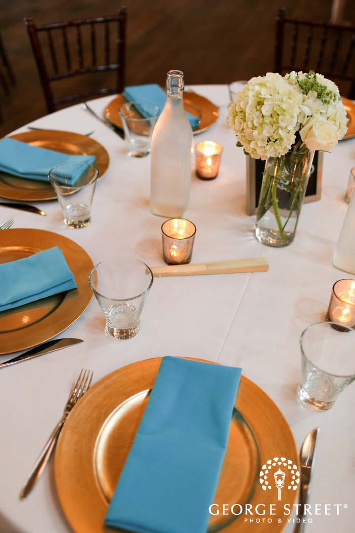 blue and gold indoor wedding table settings