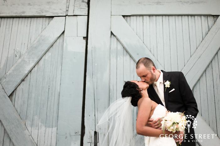 bride and groom outdoor barn wedding portraits