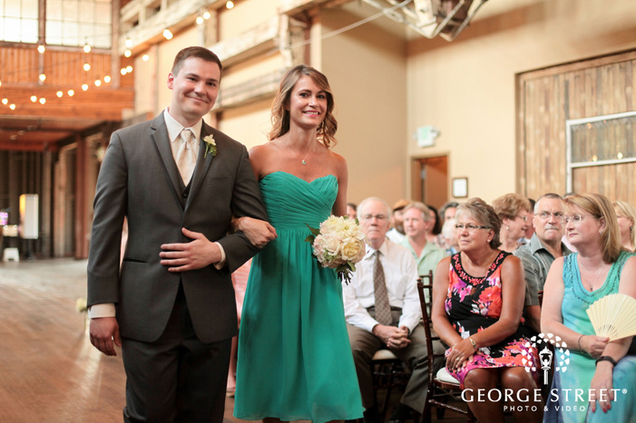 bridesmaid and groomsman indoor wedding ceremony