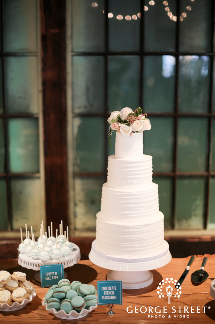elegant white wedding cake and dessert table inspiration