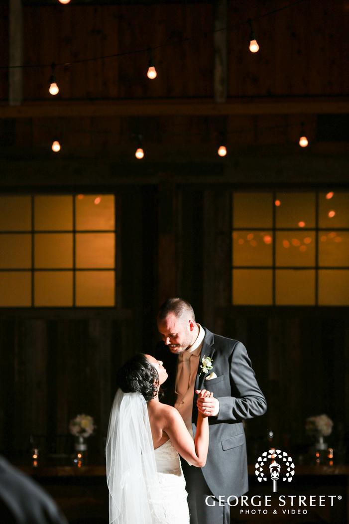 indoor wedding first dance spotlight