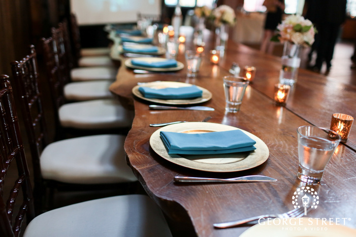 rustic blue and gold indoor wedding table settings