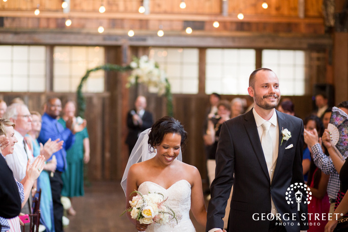 smiling bride and groom ceremony exit