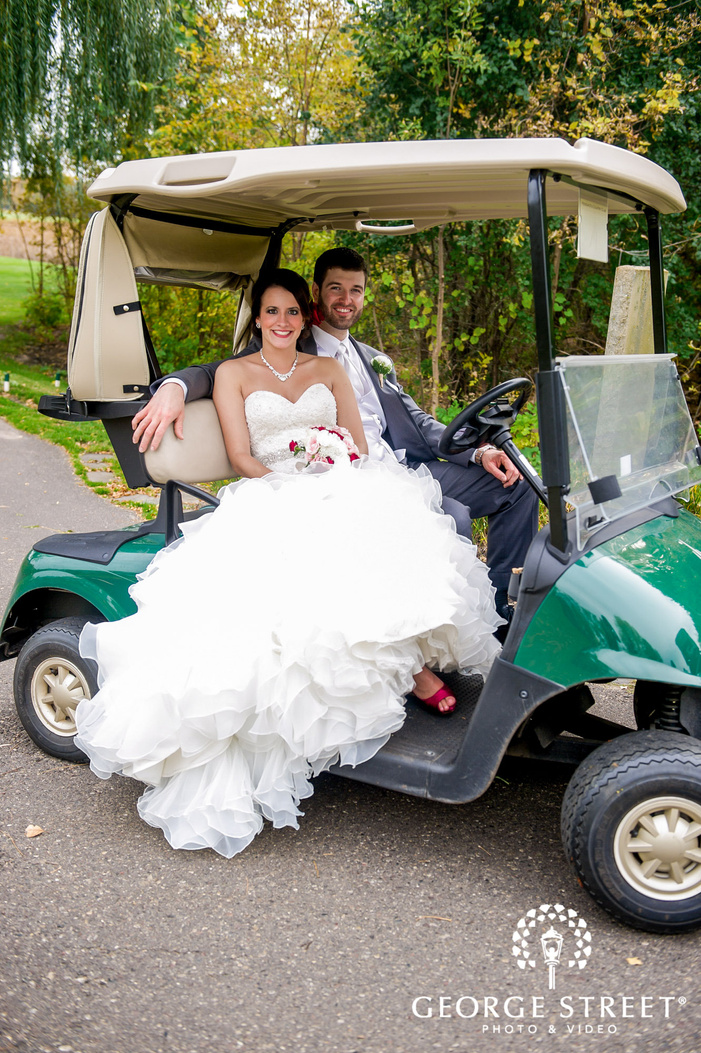 happy bride and groom in golf cart wedding photography