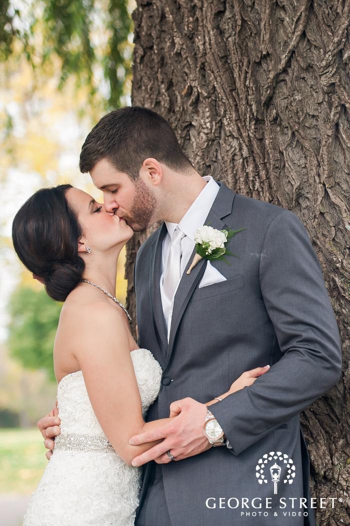 loving bride and groom near a tree wedding photos