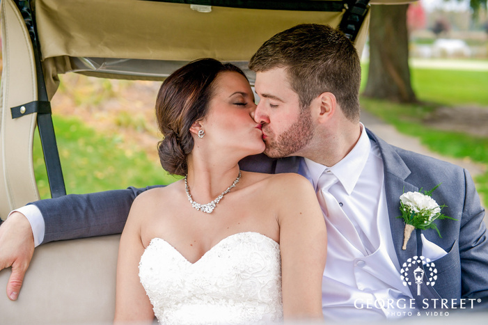 romantic bride and groom inside a golf cart wedding photography