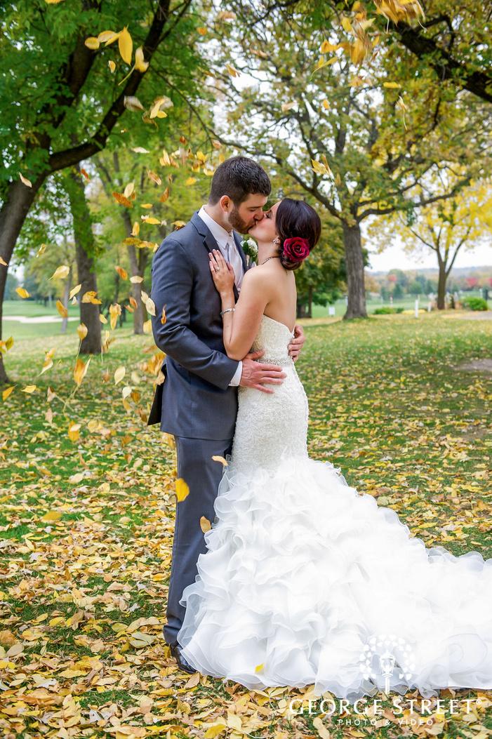 romantic bride and groom on autumn leaves walkway wedding photos