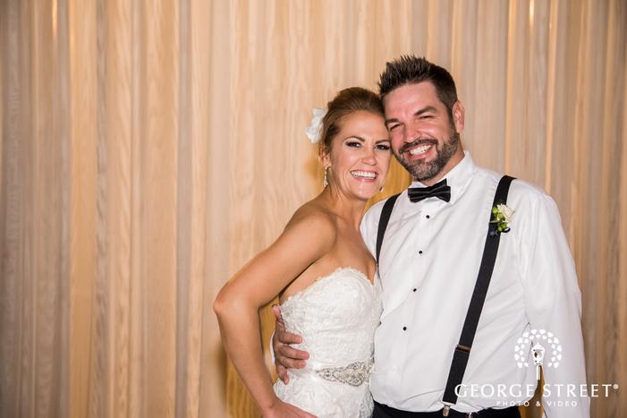 attractive bride with groomsman wedding photo