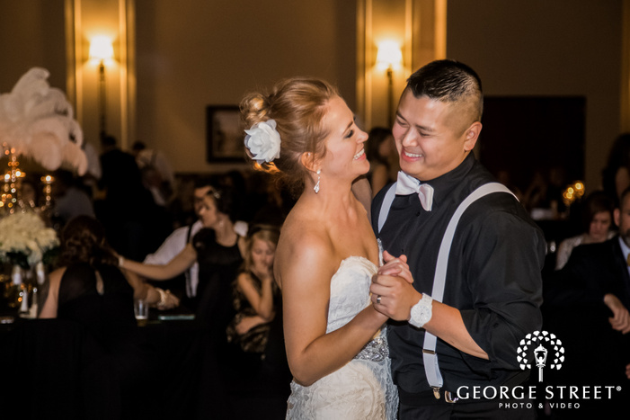 excited bride and groom on reception dance