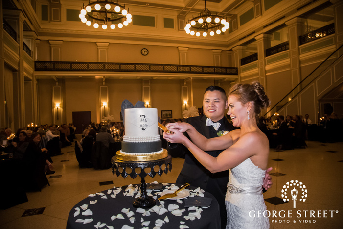 happy bride and groom on cake cutting ceremony