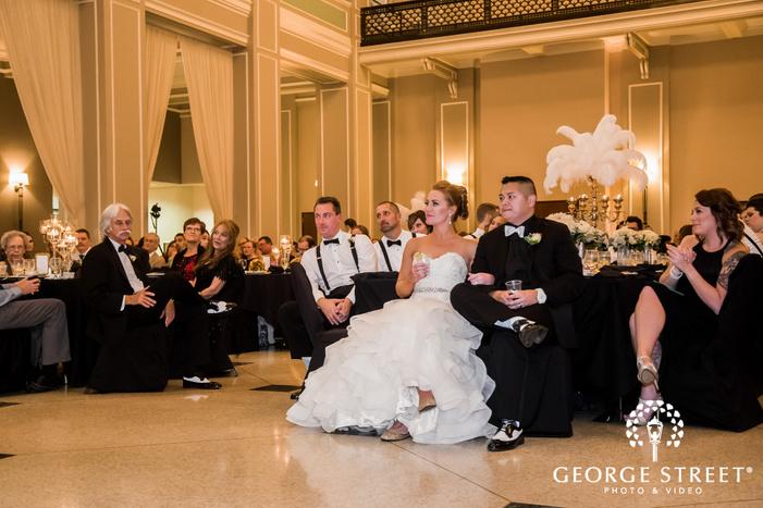 joyful bride and groom on reception toast