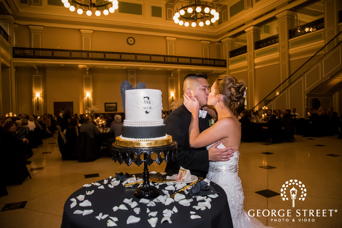 lovable bride and groom on cake cutting ceremony