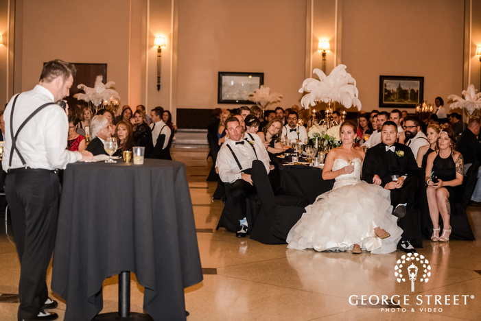 lovely couple and groomsman on reception toast