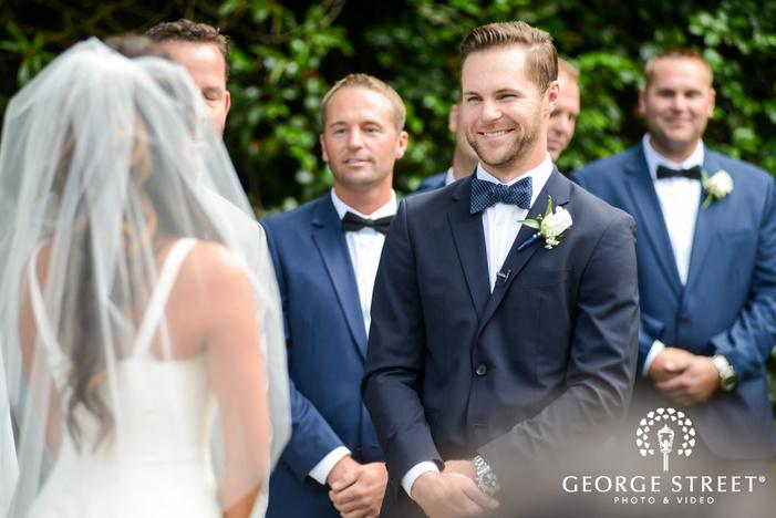 happy groom outdoor wedding ceremony