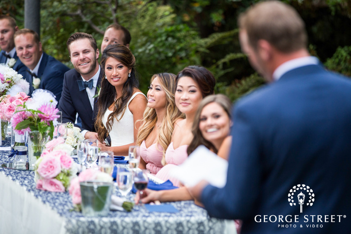 outdoor wedding reception toasts bride and groom reaction