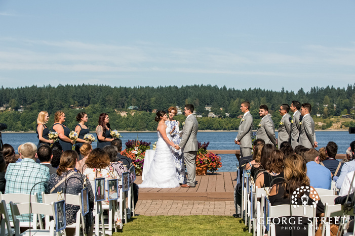 blissful bride and groom wedding vows exchange at kiana lodge in seatlte wedding photos