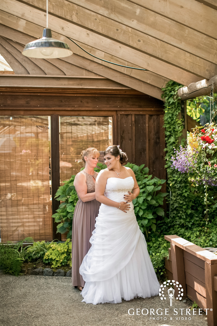 blissful bride getting ready in bridal suite wedding photo