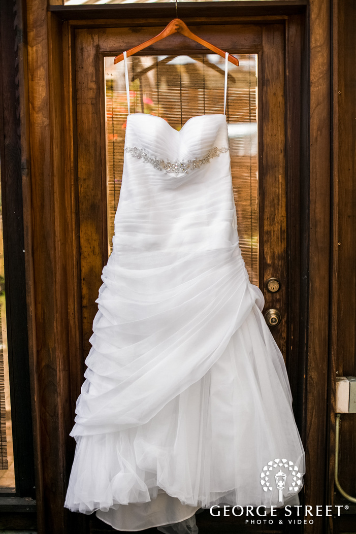 elegant bridal attire in bridal suite wedding photo