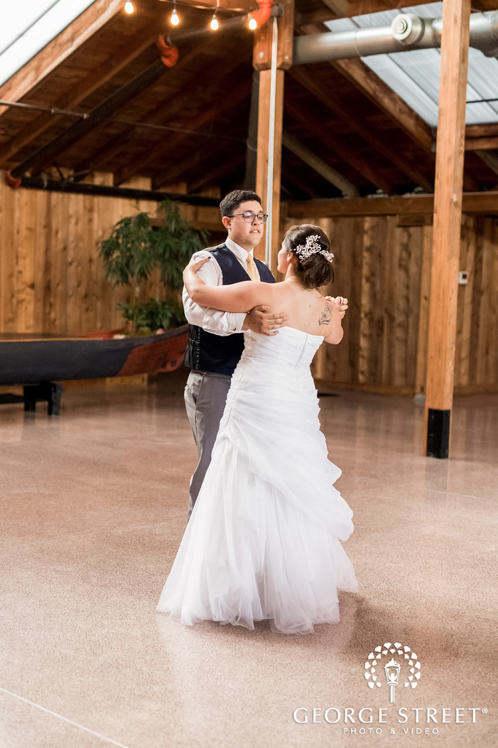 gorgeous bride and groom first dance in reception hall wedding photos