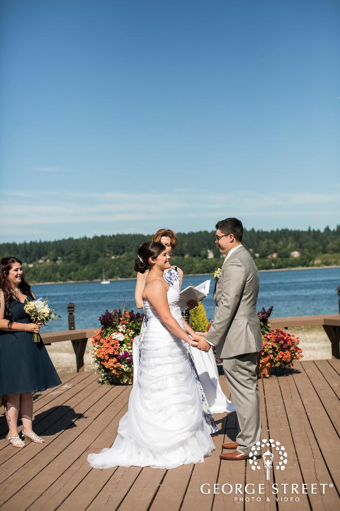 happy wedding ceremony at lakeside in seatlte wedding photos