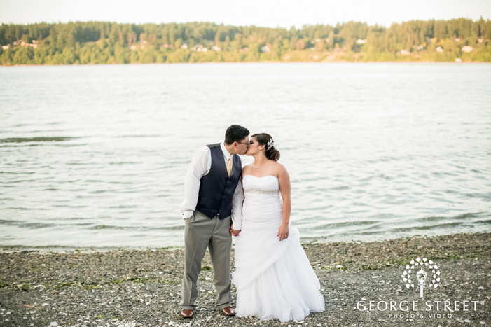 intimate bride and groom kiss at lake in seatlte wedding photography