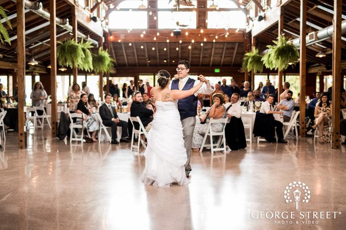 joyful bride and groom first dance in reception hall at kiana lodge wedding photo
