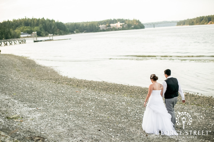 lovable bride and groom walking at lake side near kiana lodge in seatlte wedding photography