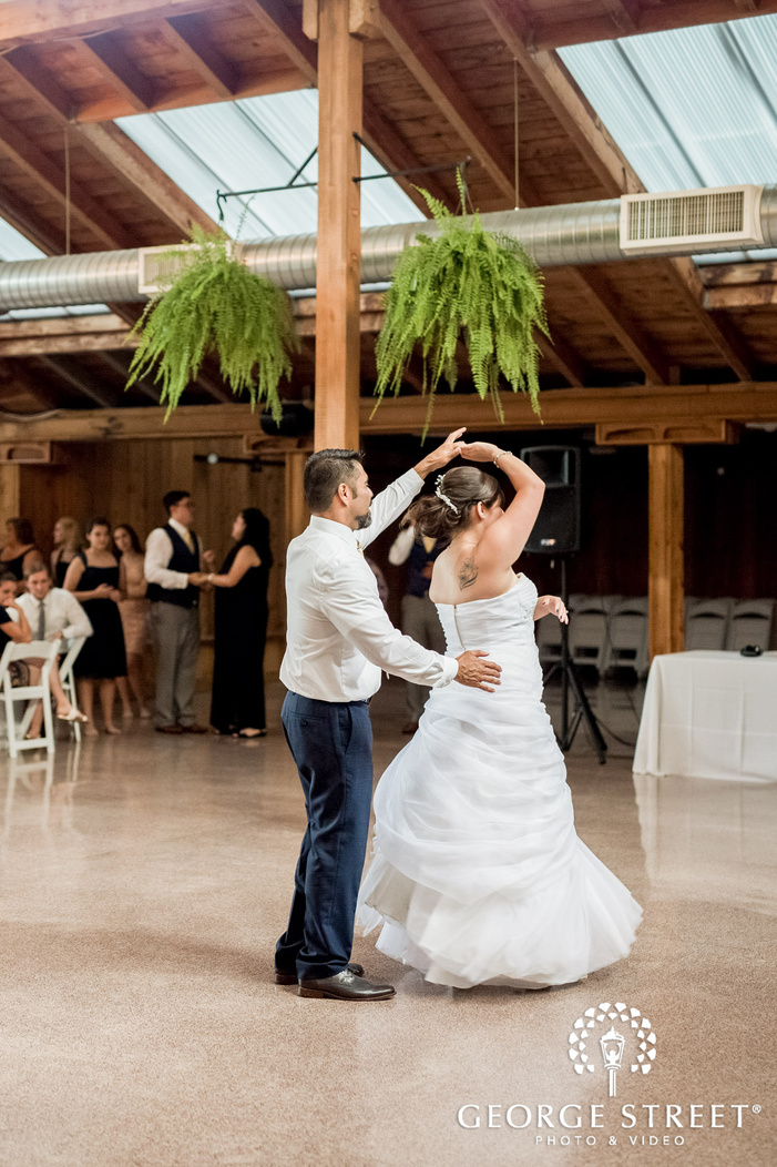 loving bride and father dance in reception wedding photo