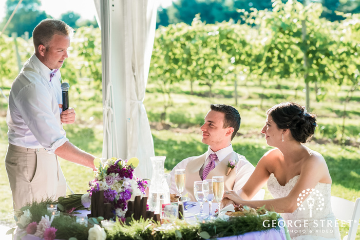 charming bride and groom during reception toast